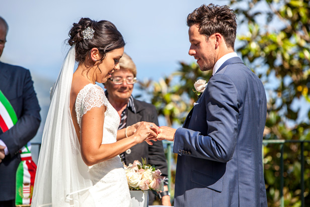 The bride and groom exchanging wedding rings | Outside wedding ceremony ideas | Leanne and Chris's Real Italian Wedding | Confetti.co.uk