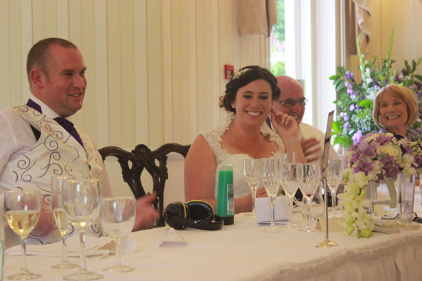 Bride and groom at the top table | Purple themed wedding| Rhiannon & Michael's Real Wedding |