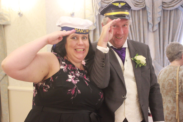 Wedding entertainment ideas   Guests using props for the photobooth   Purple themed wedding  Rhiannon & Michael's Real Wedding   Confetti.co.uk