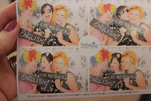 Wedding entertainment ideas  Picture of guests using props for the photobooth   Purple themed wedding  Rhiannon & Michael's Real Wedding   Confetti.co.uk