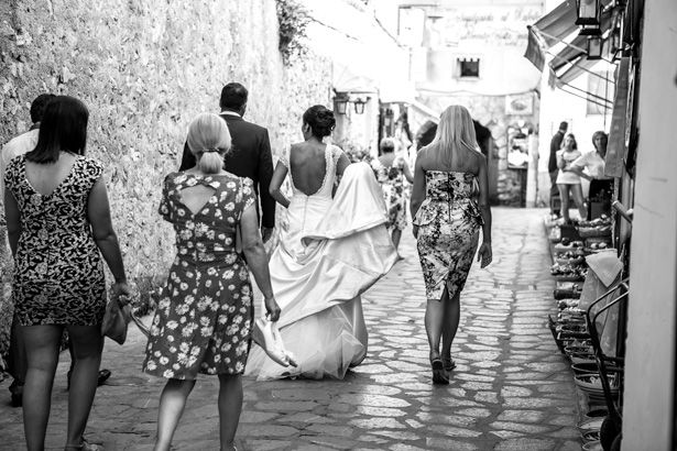 Bride and the wedding guests walking through the streets of Ravello to the wedding reception | Funny wedding moments | Leanne and Chris's Real Italian Wedding | Confetti.co.uk