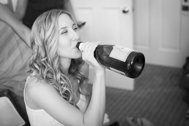 Bride drinking champagne from the bottle as she gets ready | Crystal & Giampaolo California Real Wedding |Destination Wedding America | Confetti.co.uk