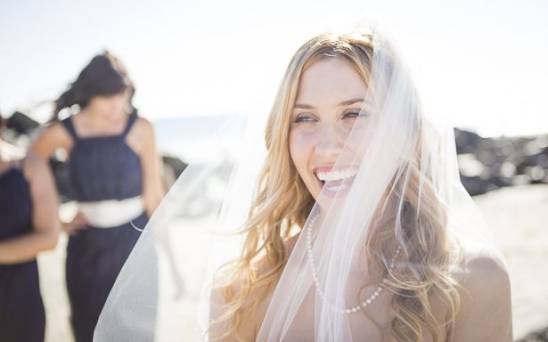 Bride laughing with her bridesmaids on the California beach  Crystal & Giampaolo California Real Wedding  Destination Wedding America   Confetti.co.uk
