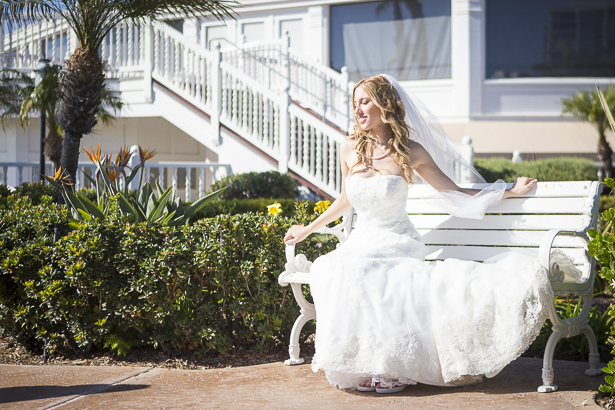 Bride sitting on the bench by the beach | Crystal & Giampaolo California Real Wedding |Destination Wedding America | Confetti.co.uk