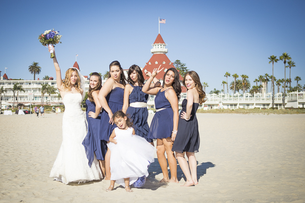 Bride with her bridesmaids and the flower girl on the beach | Funny wedding poses | Crystal & Giampaolo California Real Wedding |Destination Wedding America | Confetti.co.uk
