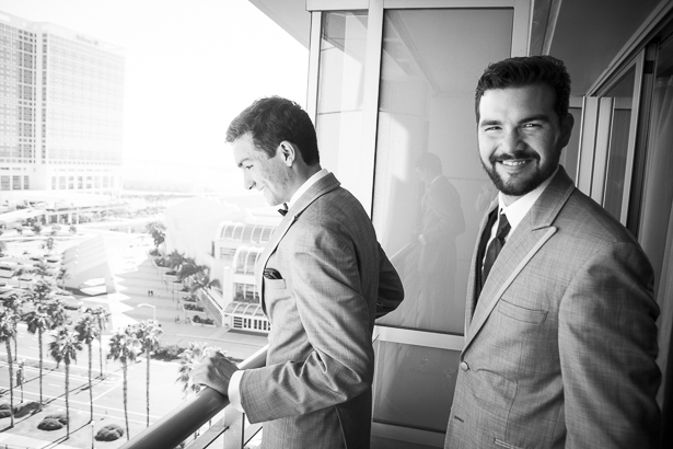 Groom and his best man ready for the wedding standing on the balcony | Crystal & Giampaolo California Real Wedding |Destination Wedding America | Confetti.co.uk