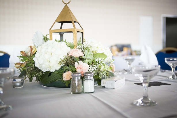 Beach themed wedding centrepieces   Gold lamp with white hydrangeas, and pink carnations   Crystal & Giampaolo California Real Wedding  Destination Wedding   Confetti.co.uk