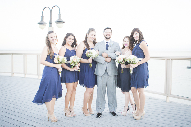 The groom with the bridesmaids on the pier | Beach wedding | Crystal & Giampaolo California Real Wedding |Destination Wedding | Confetti.co.uk