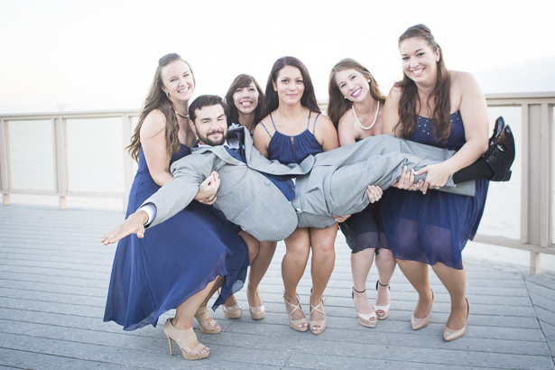 The bridesmaids lifting the groom | Funny wedding photo ideas | Crystal & Giampaolo California Real Wedding |Destination Wedding | Confetti.co.uk
