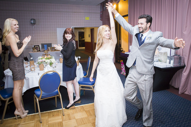 Bride and groom dancing as they enter the reception room   Crystal & Giampaolo California Real Wedding  Destination Wedding   Confetti.co.uk