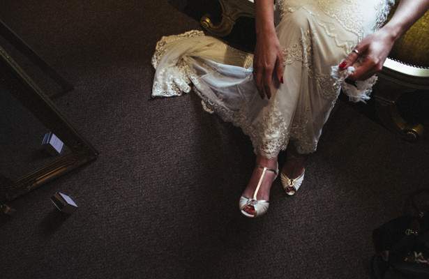 Bride in her lace wedding dress from Monsoon and white pep toe shoes| Steph and Gary's Real Garden Wedding | Confetti.co.uk