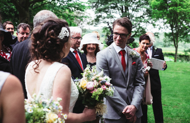 The bride and groom at together for their garden wedding ceremony | Garden wedding ideas | Steph and Gary's Real Garden Wedding | Confetti.co.uk