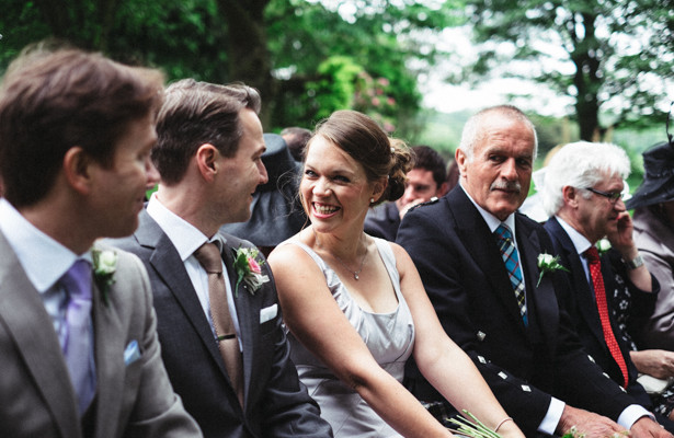 Wedding guests enjoying the garden ceremony | Garden wedding ideas | Steph and Gary's Real Garden Wedding | Confetti.co.uk