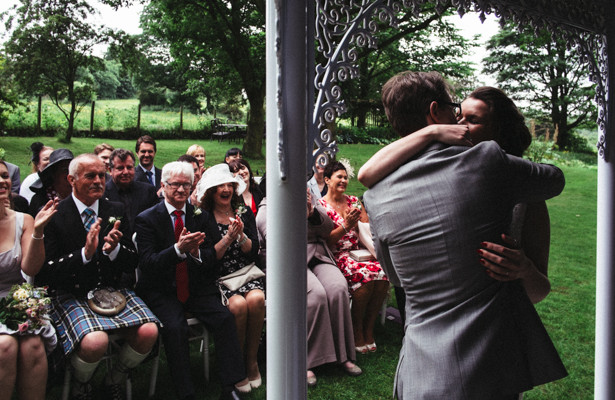 The bride and grooms first kiss as husband and wife   Garden wedding ideas   Steph and Gary's Real Garden Wedding   Confetti.co.uk