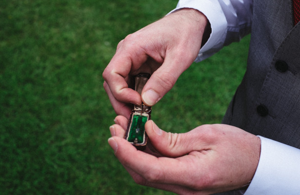 Groom holding a vintage ring box | Steph and Gary's Real Garden Wedding | Confetti.co.uk