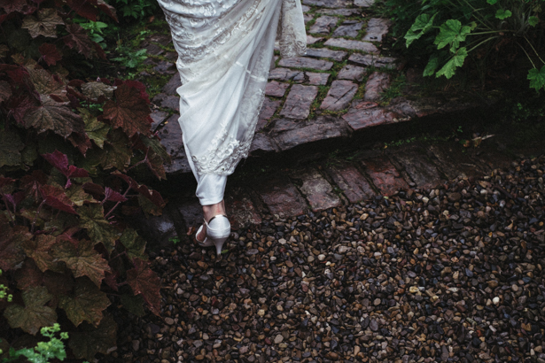 The bride walking through the garden | Vintage wedding ideas | Steph and Gary's Real Garden Wedding | Confetti.co.uk