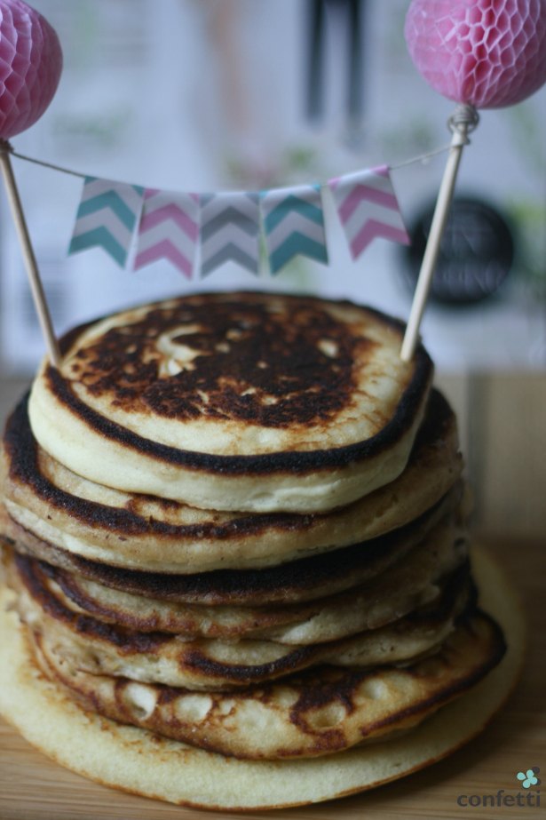 A stack of pancakes with Confetti.co.uk's Chevron Bunting Cake Topper