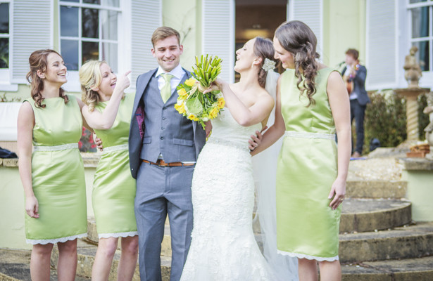 Bride and groom with their bridesmaids | Spring wedding theme ideas | Wedding at the Deer Park country house | Nadine and Roberts Real Wedding | Confetti.co.uk
