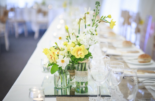 Daffodils and yellow tulips wedding centrepiece | Spring wedding theme ideas | Wedding at the Deer Park country house | Nadine and Roberts Real Wedding | Confetti.co.uk