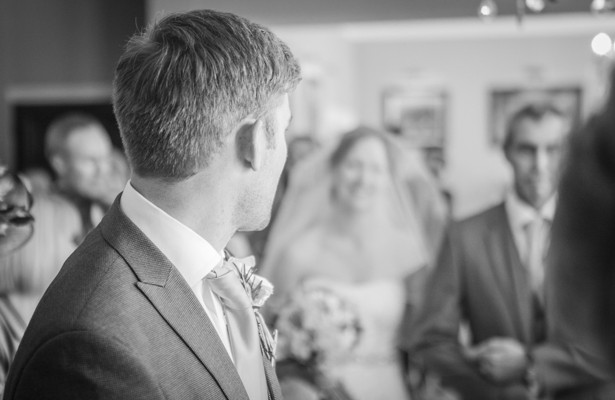 Groom seeing his bride for the first time | Wedding ceremony at the Deer Park country house  | Nadine and Roberts Real Wedding | Confetti.co.uk