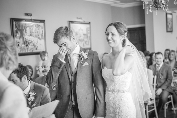 Emotional bride at groom during the ceremony | Wedding ceremony at the Deer Park country house | Nadine and Roberts Real Wedding | Confetti.co.uk