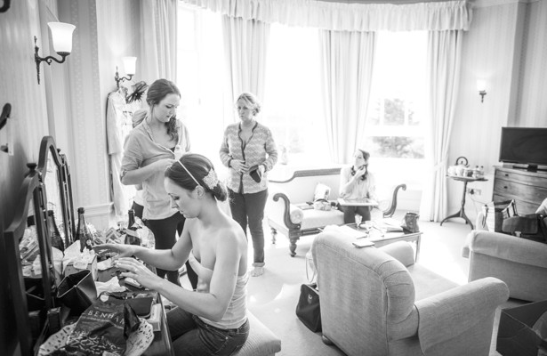 Bride and bridesmaids getting ready for the wedding| DIY wedding make up idea | Nadine and Roberts Real Wedding | Confetti.co.uk