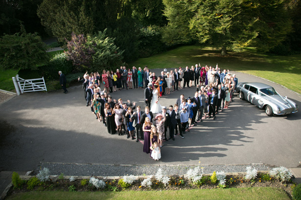 The guests in a heart shape with the bride and groom in the middle | Wedding pictures you have to capture | Lizzie and Greg's Real Wedding | Confetti.co.uk