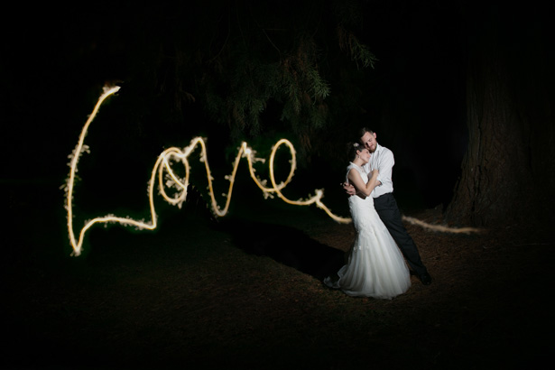Love message using sparklers | Lizzie and Greg's Real Wedding | Confetti.co.uk