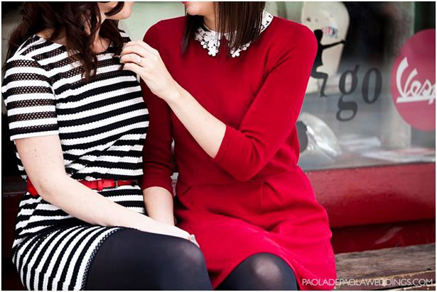 The  brides to be outside the coffee shop | Red peter pan collar dress | Black and white stripped dress with red belt | Engagement shoot ideas | Confetti.co.uk