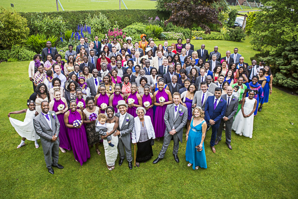Group shot of the bride and groom with her wedding guests   Precious and Jerald's real wedding   Confetti.co.uk
