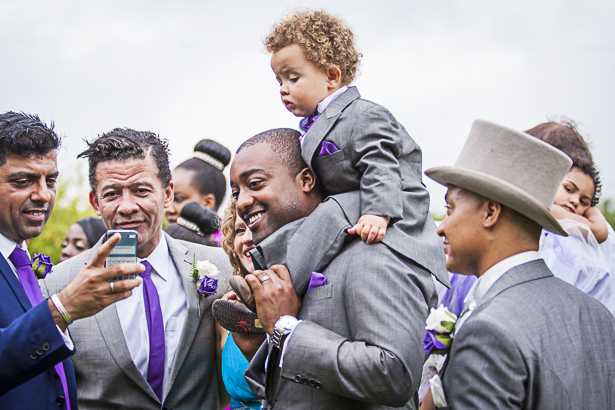 Groom with the page boy on his shoulder | Precious and Jerald's real wedding | Confetti.co.uk