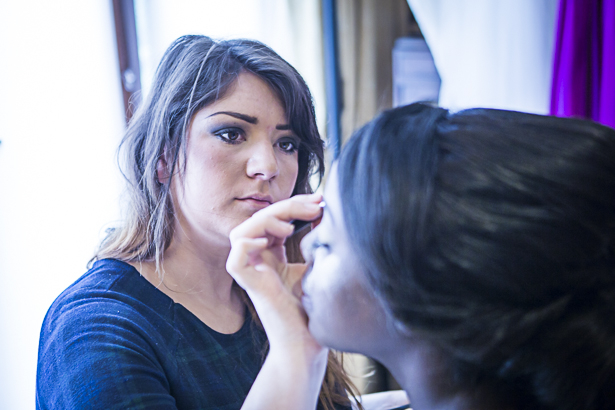 The makeup artist doing the brides eye shadow | Precious and Jerald's real wedding | Confetti.co.uk