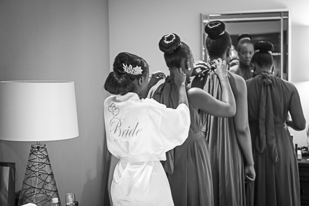Bride and bridesmaids helping each other get ready | Wedding moments to capture | Precious and Jerald's real wedding | Confetti.co.uk