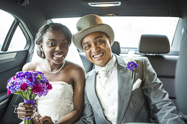 The newlyweds leaving the church in a car | Precious and Jerald's real wedding | Confetti.co.uk
