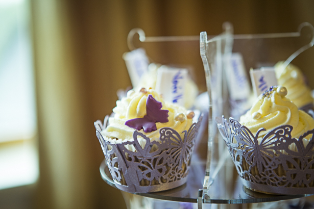 Cupcakes with purple butterfly wraps | Precious and Jerald's real wedding | Confetti.co.uk
