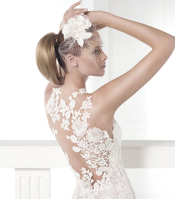 Lace wedding dress with low back | Confetti.co.uk