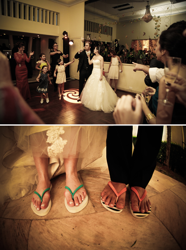 The bride and groom toasting their marriage | The newlyweds wearing flip flops |Claudia and Felipe's Intiamte Wedding | Confetti.co.uk
