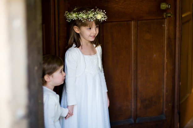 Flowergirls walking out of the church wedding