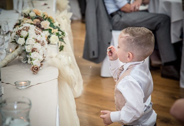 Page Boy Blowing Bubbles at a wedding