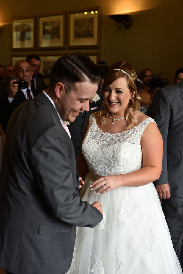 Laura and Daniel share a laugh during their ceremony