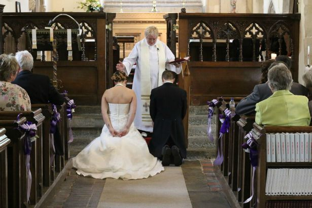 Bride and groom in church at Jess and Ryan's real wedding | Confetti.co.uk