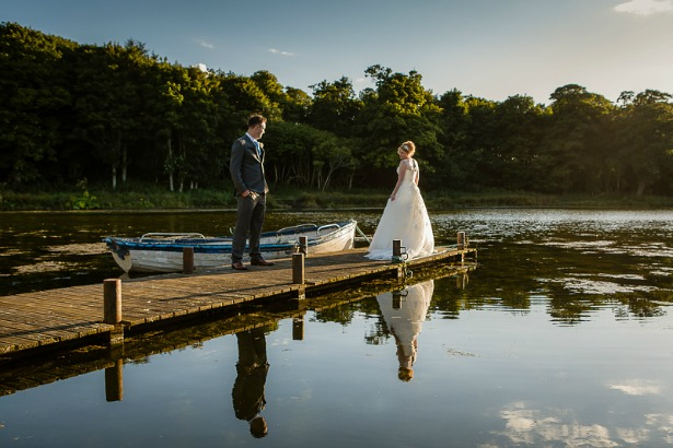 Bride and groom by boating lake by GWS Photography | Confetti.co.uk