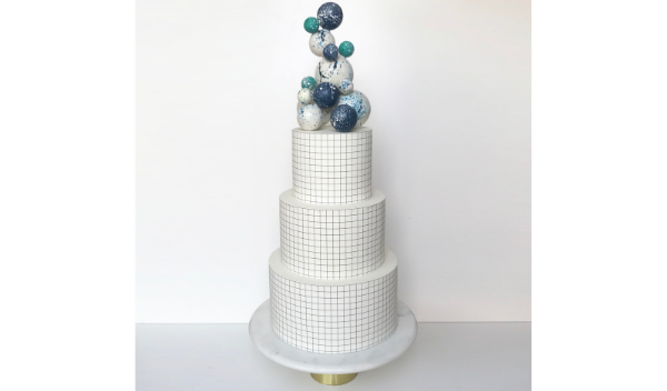 quirky white wedding cakr