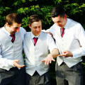 A groom and two groomsmen in smart casual attire | Confetti.co.uk