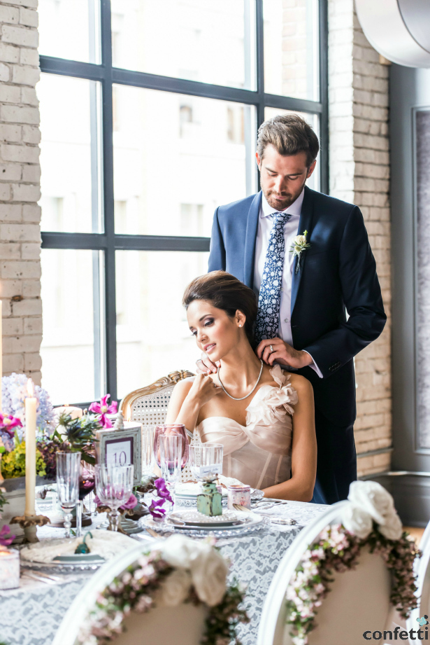 A groom being a gentleman to his partner | Confetti.co.uk