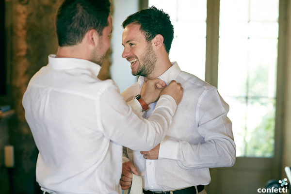 A groom getting some help on his wedding day | Confetti.co.uk
