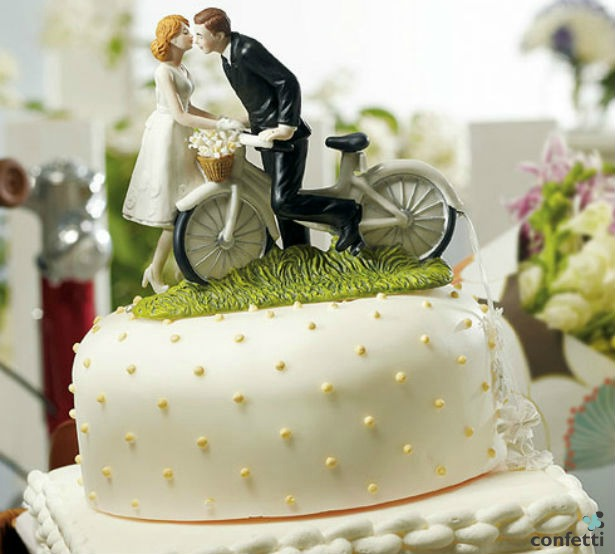 A kiss above bicycle cake topper | Confetti.co.uk