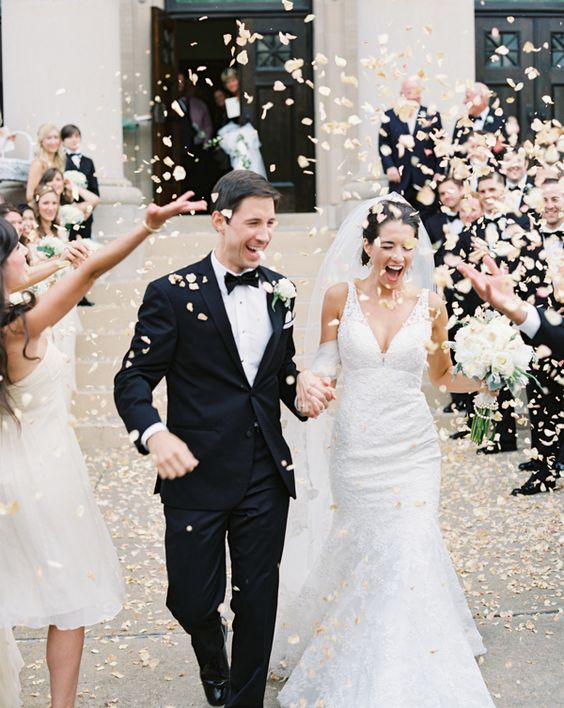Confetti being thrown at bride and groom| Confetti.co.uk