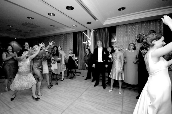 Tossing the bouquet at the wedding | Confetti.co.uk