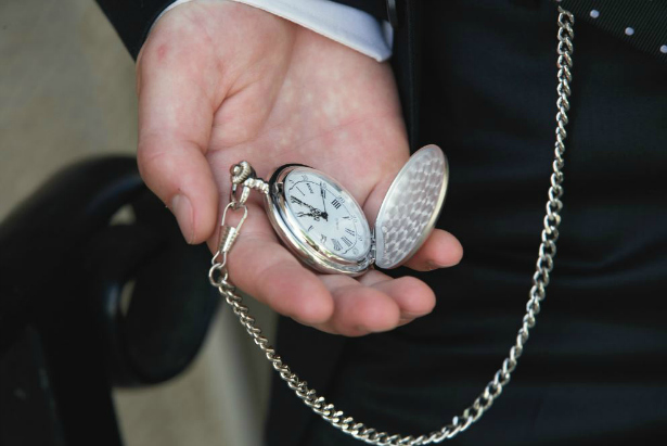 Pocket Watch in hand | Confetti.co.uk